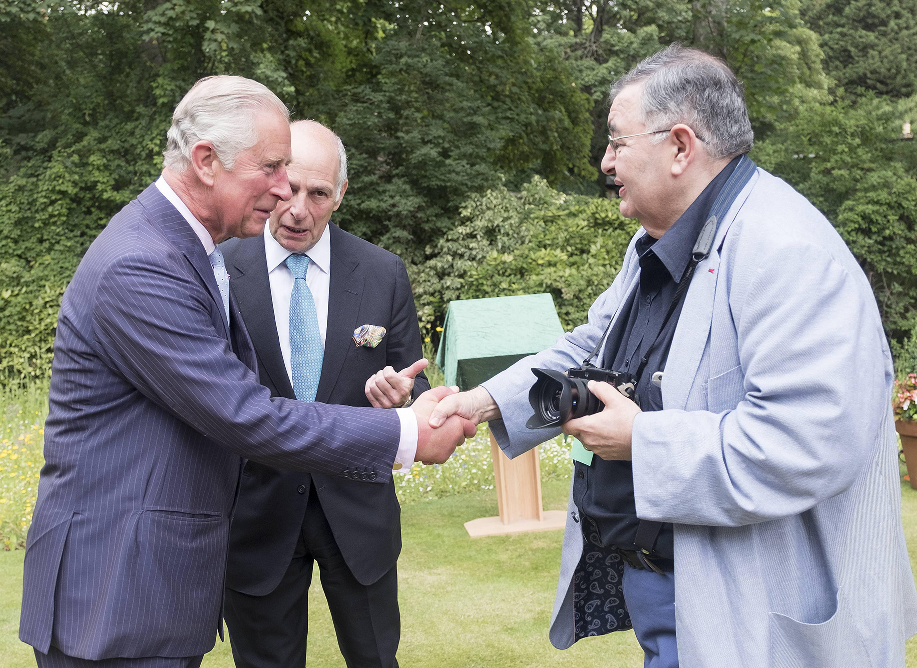 BRITAIN London 13/07/2017HRH The Prince of Wales with the Shire Horses of Operation Centaur at the launch of the Royal Parks Charity Pictured: Prince Charles is introduced to Daily Express photographer Paul Stewart who wrote the book The Last Herd about the Royal Parks Shire horses©Vivien Stewart 2016@@PS_HRH1029.JPG