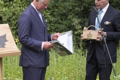 BRITAIN London 13/07/2017HRH The Prince of Wales with the Shire Horses of Operation Centaur at the launch of the Royal Parks Charity. Here Prince Charles reads the book The Last Herd by Daily Express photographer Paul Stewart about the Royal Parks Shire horses©Paul Stewart 2016@@PS_HRH1027.JPG