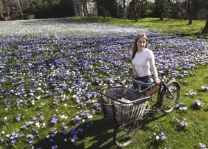 Scene at Kew Gardens as the 4.5 Million crocus bulbs in the lawn burst into bloom. In the picture Kew's Lauren Bird poses with the flowers. © Paul Stewart 2005