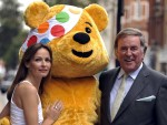 TERRY WOGAN AND SHARON CORR WITH PUDSEY BEAR - OPS Stars including Sir Terry Wogan, Sharon Corr, Hayley Westebra, Nick Mason and Lee Mead turn out to launch the Banaged Together CD for BBC Children in Need at the BBC Club in London Sharon and Sir Terry 05/11/2009 © Paul Stewart 2009 07917 65 26 36@@17469718.jpg