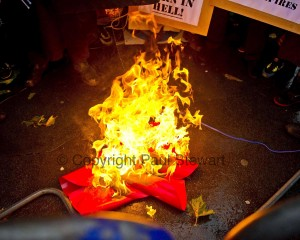 Muslim extremists disrupt the 2 minute silence for Poppy Day, by burning Poppies and screaming British Soldiers Burn In Hell outside the Royal Geographical Society. ©Paul Stewart 2010