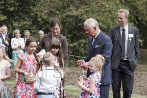 BRITAIN London 06/09/2016 Prince Charles inaugurates the 90th birthday Coronation Meadow to mark the Queen's 90th year by scattering wild seed with some school children. At one point he got the seed in his trouser turn up an had to shake a leg to get it out. ©©{copyright}